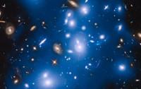 Imagen del Hubble del Cúmulo de Pandora coloreada artificialmente en azul para mostrar la luz procedente de estrellas intergalácticas -NASA, ESA, IAC-